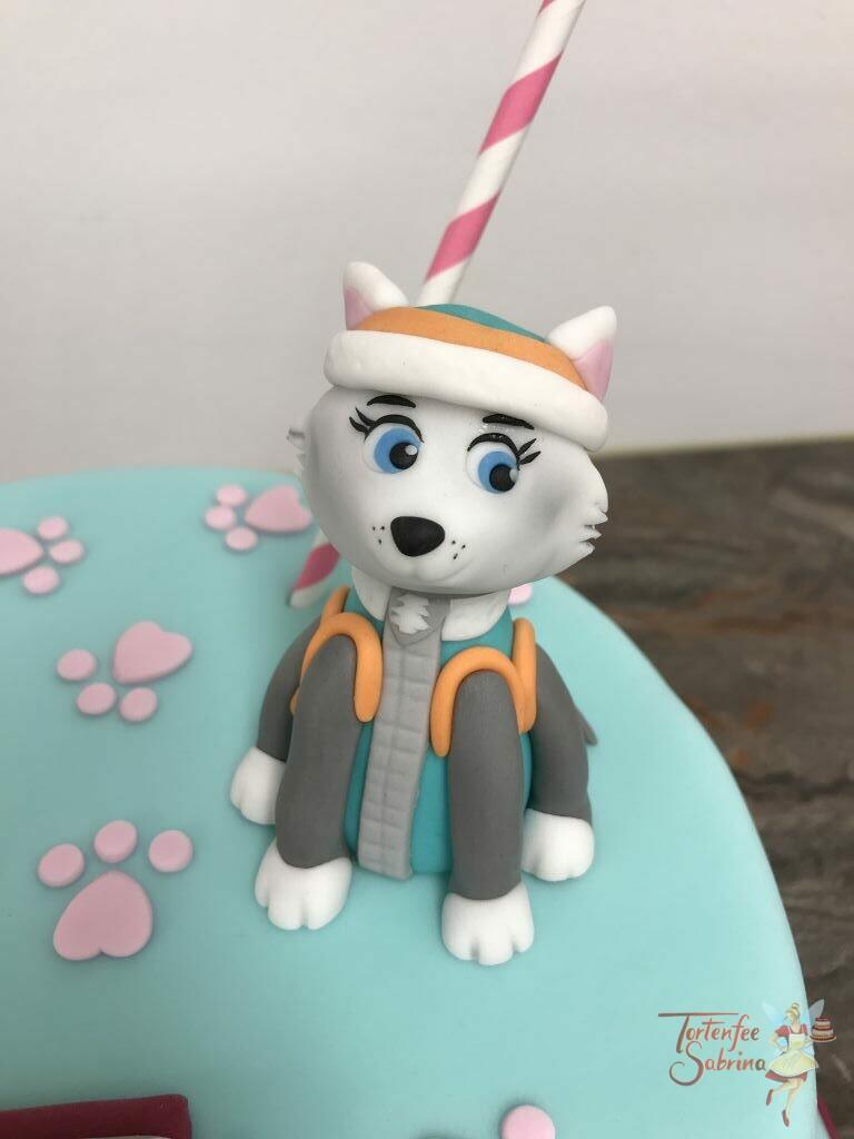 Geburtstagstorte Mädchen - Everest trifft Skye und sitzen auf der Torte zwischen Pfotenabdrücken und unter der Girlande.