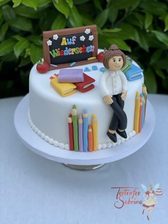 Anlasstorte - Auf Wiedersehen, Frau Lehrerin. Die sitz auf der Torte vor ihrer Tafel und zwischen vielen Büchern.