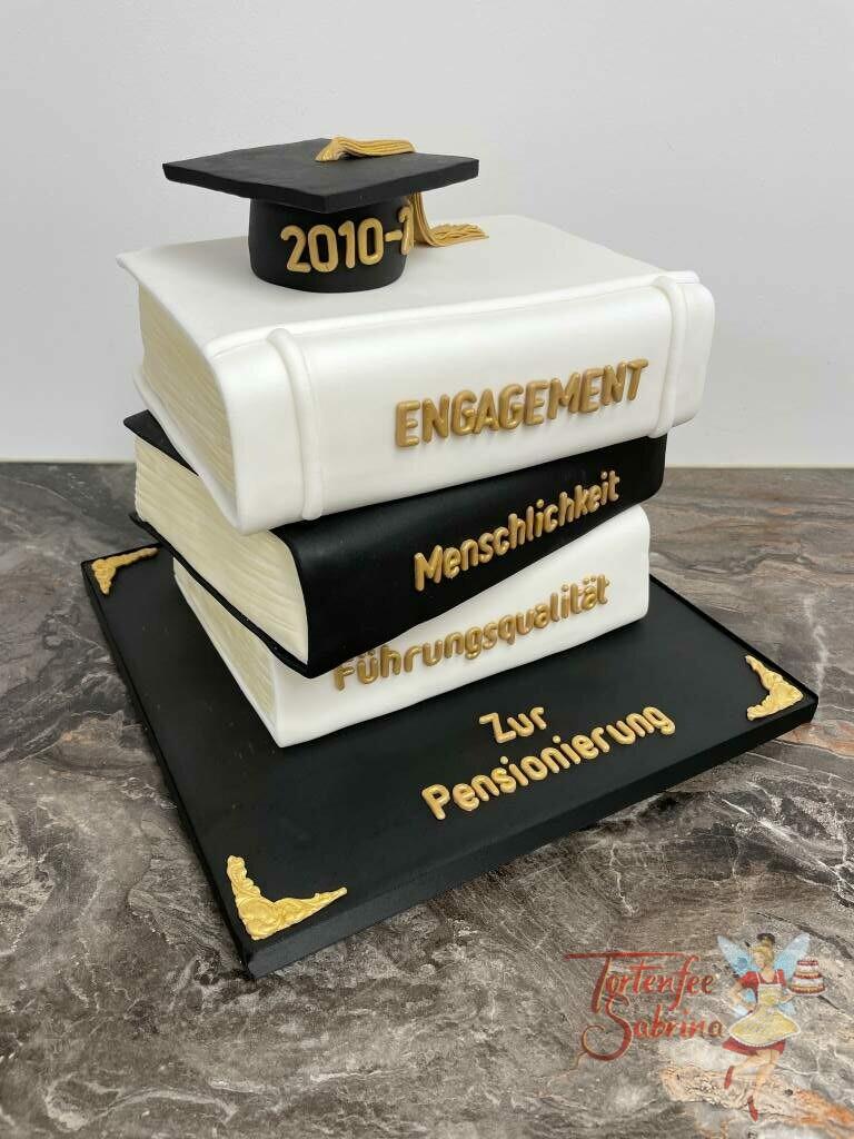 Anlasstorte - Bücher des Erfolgs sind hier in Form des Bücherstapels dargestellt, in den Farben weiß und schwarz mit goldenen Buchstaben.