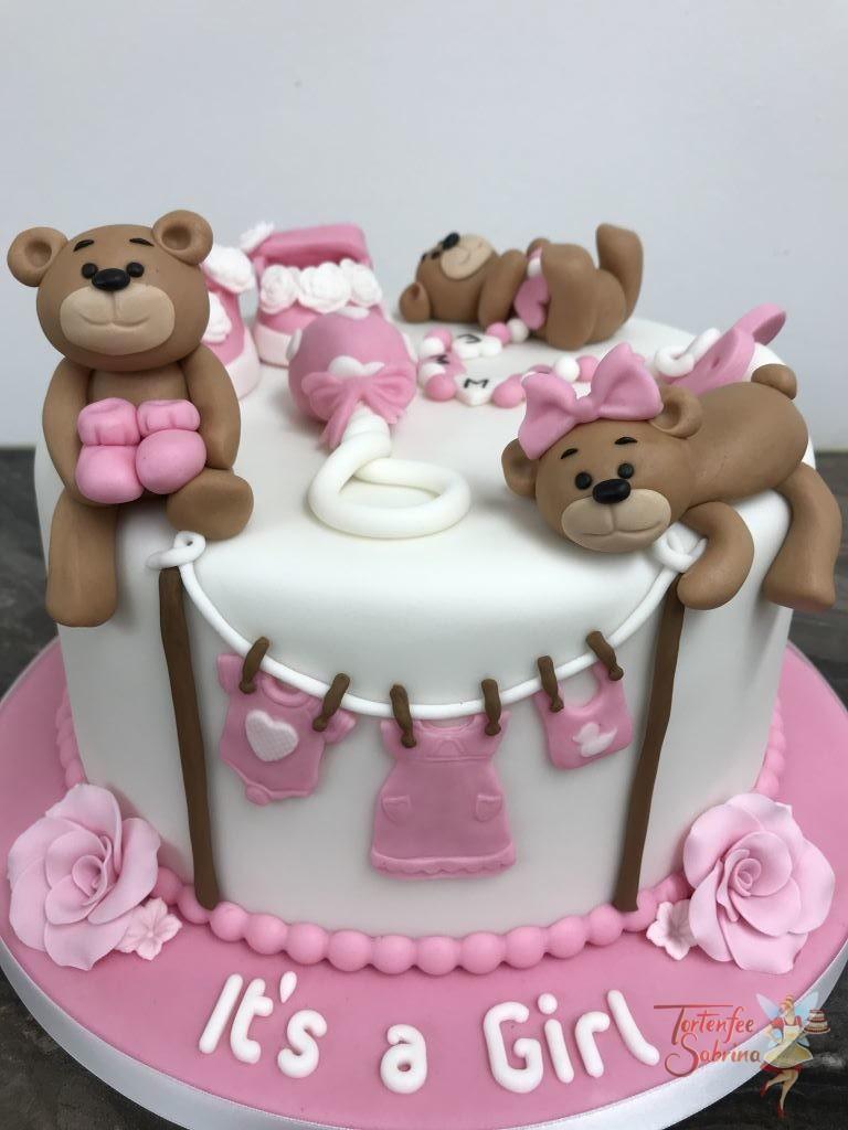 Babytorte - Babybärchenparty. Die Bärchen spielen mit Schüchen, Schnullerkette, Babyrassel und der Wäscheleine, alles in rosa.
