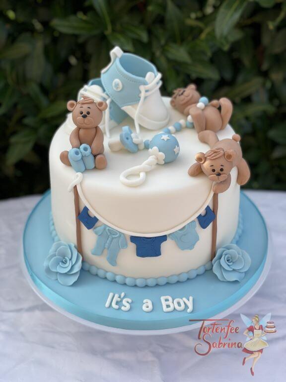 Babytorte - Drei lustige Bärchen oben auf der Torte welche die Wäscheleine Halten und die Schüchen halten.