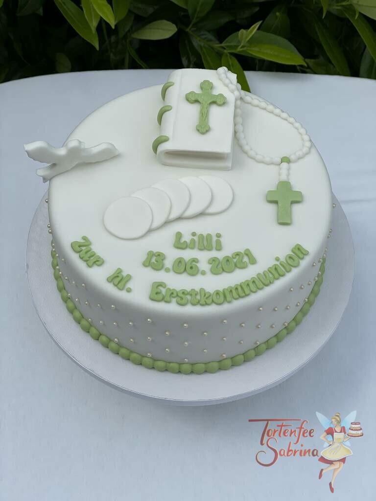 Erstkommunionstorte - Bibel mit Hostie und Taube, ebenfalls wurde die Torte mit einer grünen Perlenkette und einzelnen Perlen verziert.