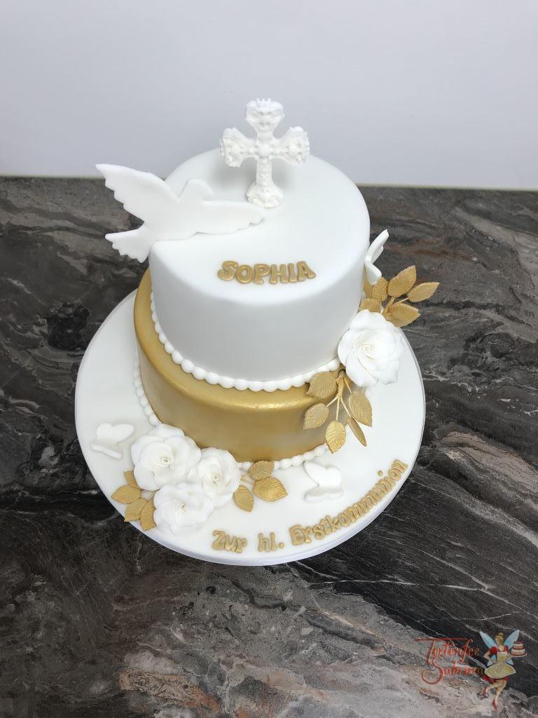 Erstkommunionstorte - Gold mit Taube und Kreuz. Diese Torte wurde vergoldet, ebenso die Blätter der weißen Rosen welche die Torte zieren.