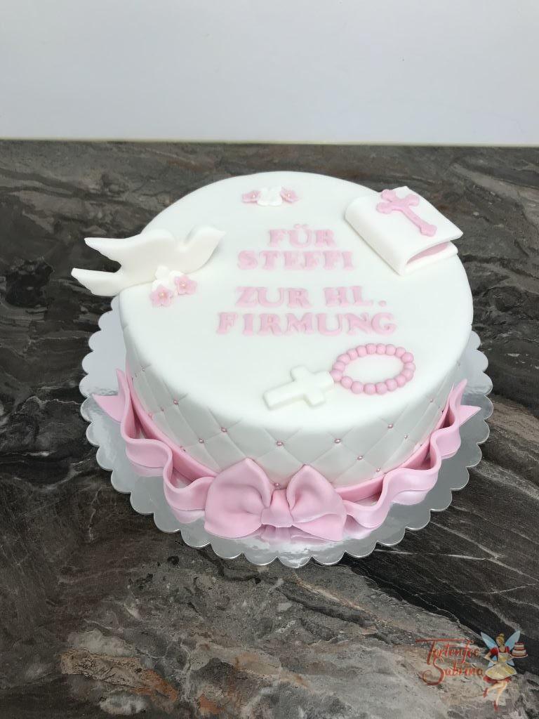 Firmungstorte - Taube und rosa Schleife. Diese Torte wurde seitlich mit einem Rautenmuster mit Perlen verziert, oben ziert noch ein Kreuz und eine Bibel die Torte.