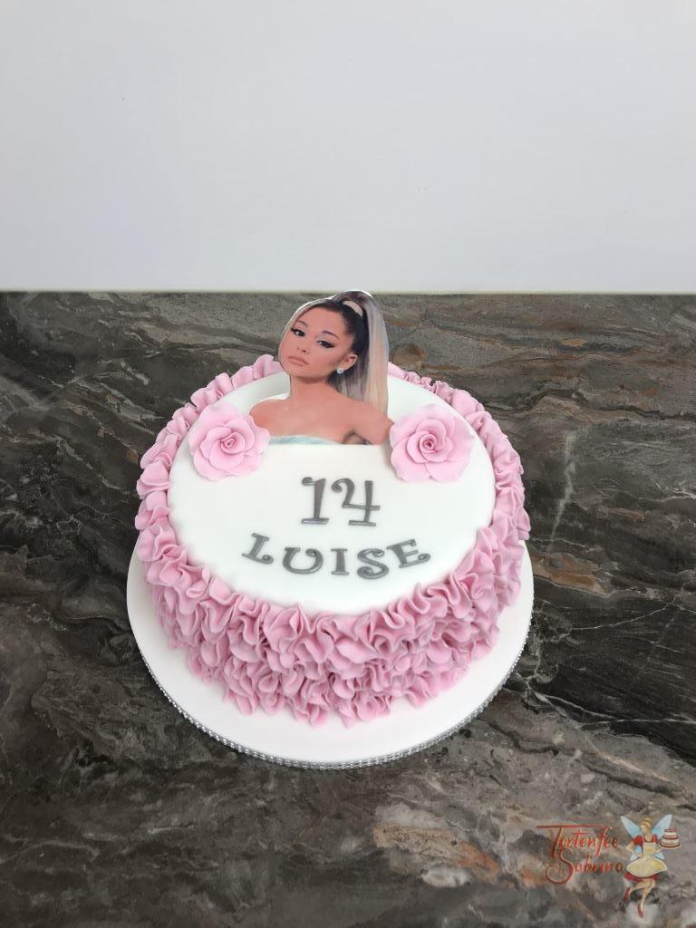 Geburtstagstorte Mädchen - Ariana Grande mit Rosenblüten, rosa Rüschen und Glitzerband.