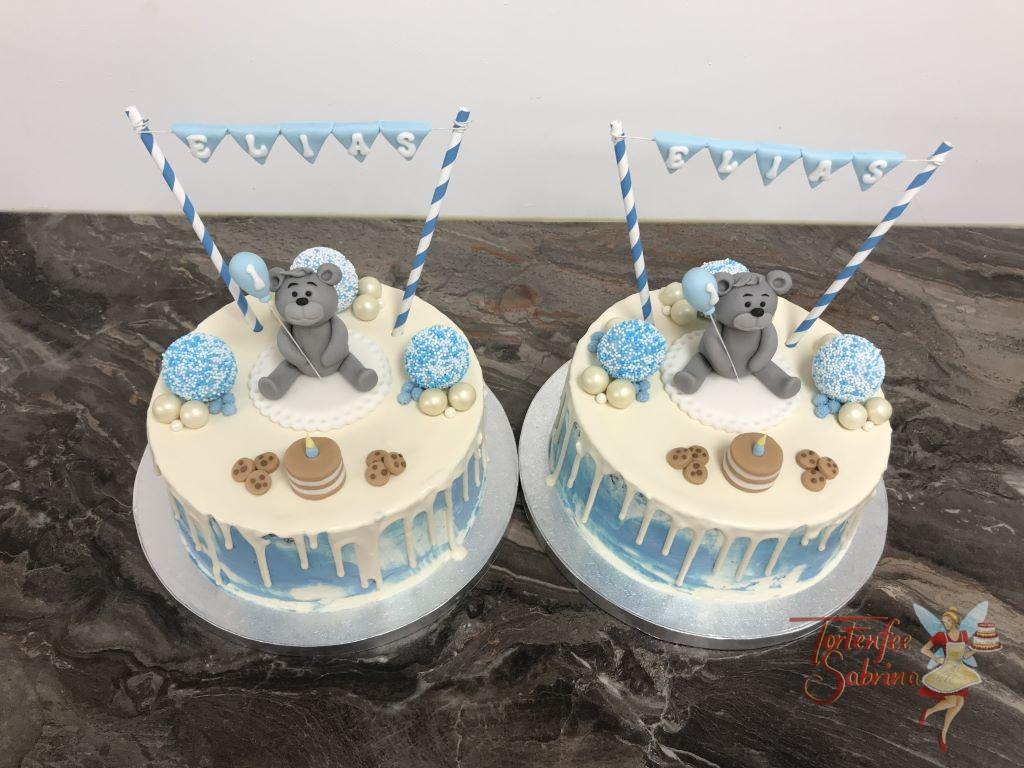 Geburtstagstorte Buben - Bär mit Ballon und Torte. Dieser Drip Cake wurde auch noch mit Cookies und Zuckerkugel sowie einer Girlande verziert.