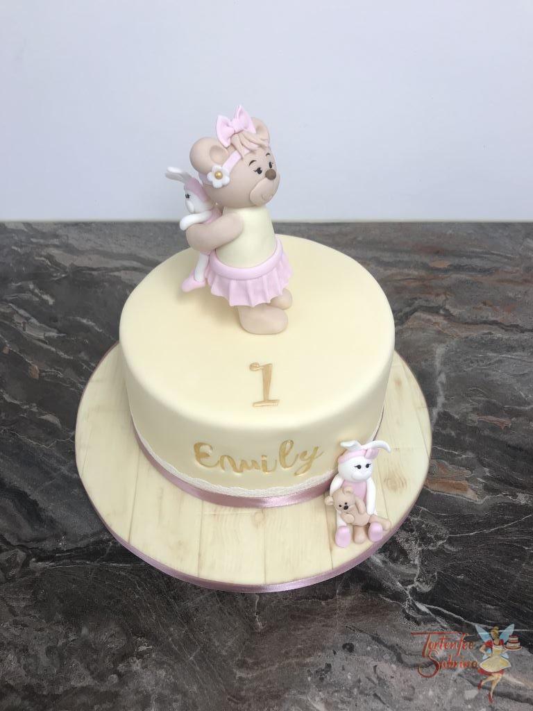 Geburtstagstorte Mädchen - Bär mit Häschen auf der Torte und neben der Torte umgekehr. Der Name ist vertieft und in goldener Farbe.