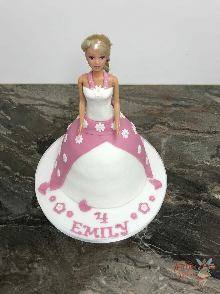 Geburtstagstorte Mädchen - Barbies Kleid wurde hier nachgebacken und in rosa und weiß eingefärbt sowie mit Blümchen verziert.