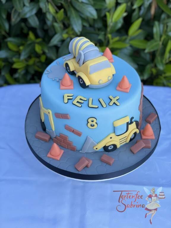 Geburtstagstorte Buben - Baustellenfahzeuge im Einsatz auf der Torte sind Betonmischer, Bagger, Radlader und viele Ziegelsteine und Hütchen.