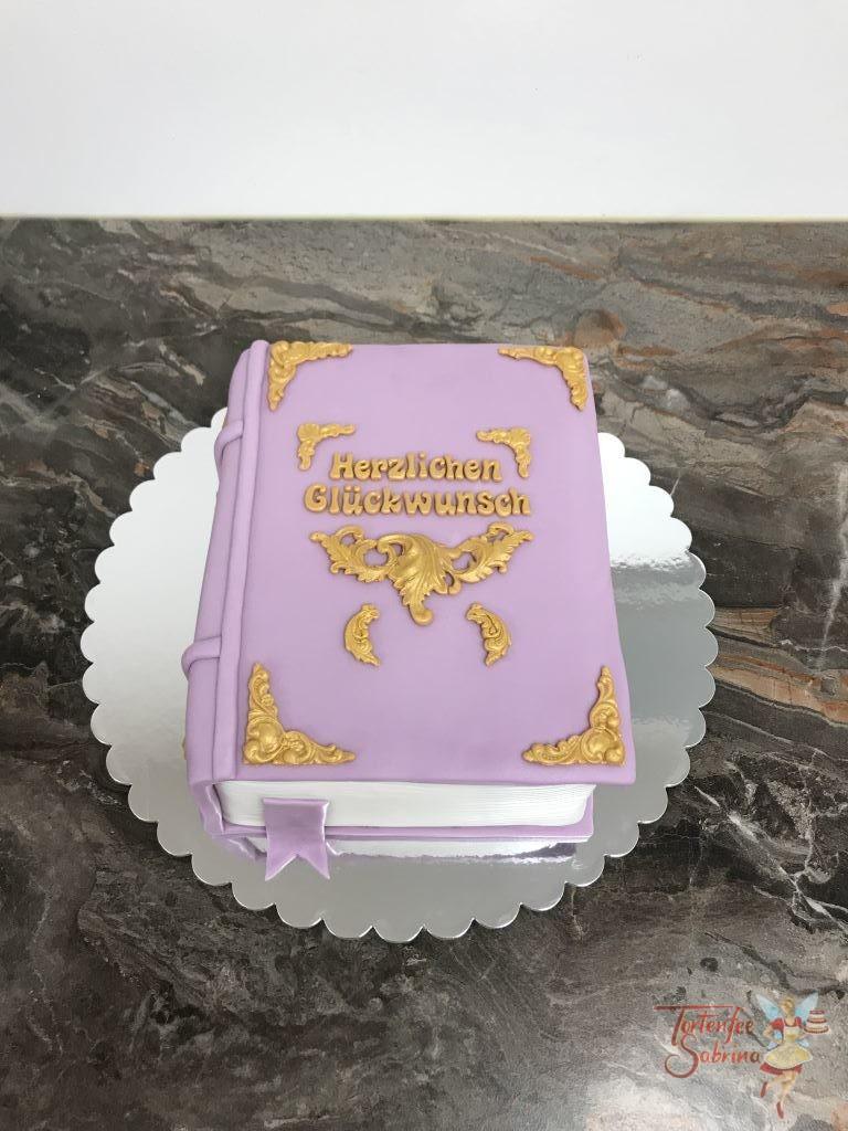 Geburtstagstorte Erwachsene - Das lila Buch, dieses ganz dicke Buch in lila gehalten mit goldener Verzierungen.