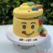 Geburtstagstorte Buben - Der Legokopf geht über den überall kommen die bunten kleinen Legosteine herraus.