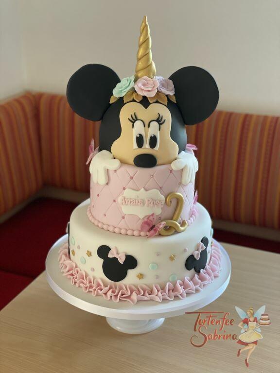 Geburtstagstorte Mädchen - Einhorn-Minnie Mouse wurde noch verziert mit bunten Blumen und goldenen Sternen.