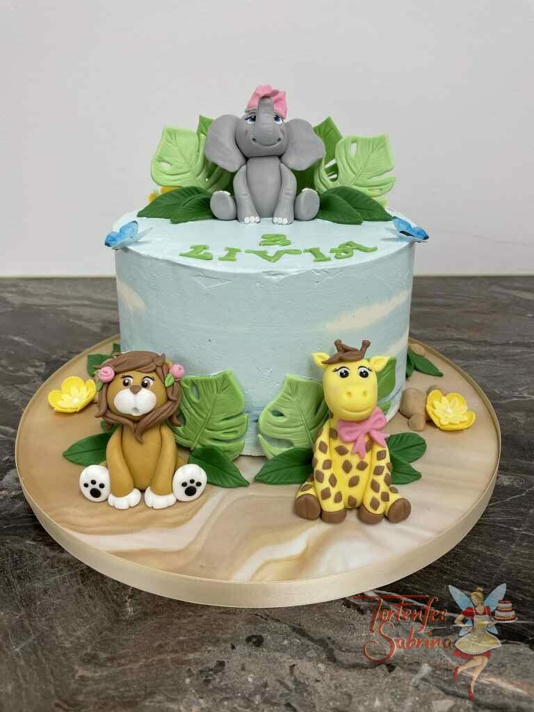 Geburtstagstorte Mädchen - Elefant mit Freunden im Dschungel, dieser sitzt zwischen den Palmblättern mit einer rosa Schleife.