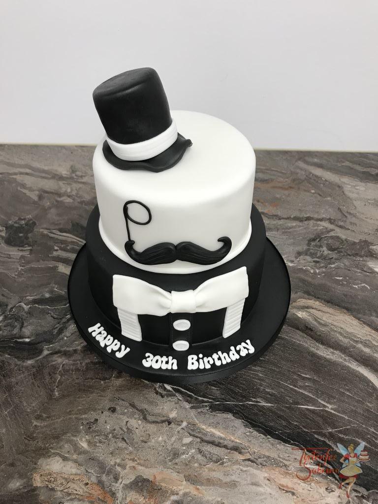 Geburtstagstorte Erwachsene - Gentleman mit Fliege. Hier wurde die 2-Stöckige Torte mit Zylinder, Monokel, Schnauzer und Smoking.