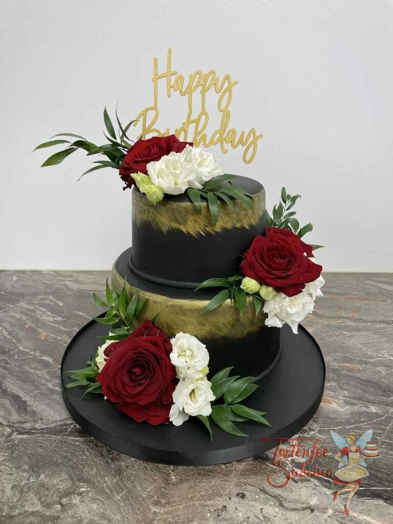 Geburtstagstorte Erwachsene - Gold und Schwarz mit Blumen und ganz oben auf der Torte ist ein Cake Topper.