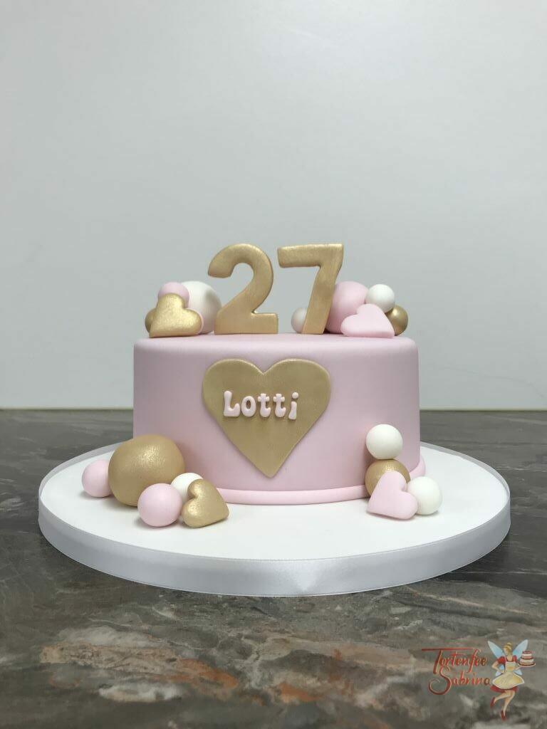 Geburtstagstorte Erwachsene - Goldenes Herz, diese Torte wurde rosa eingefärbt und mit goldenen Herzen verziert.