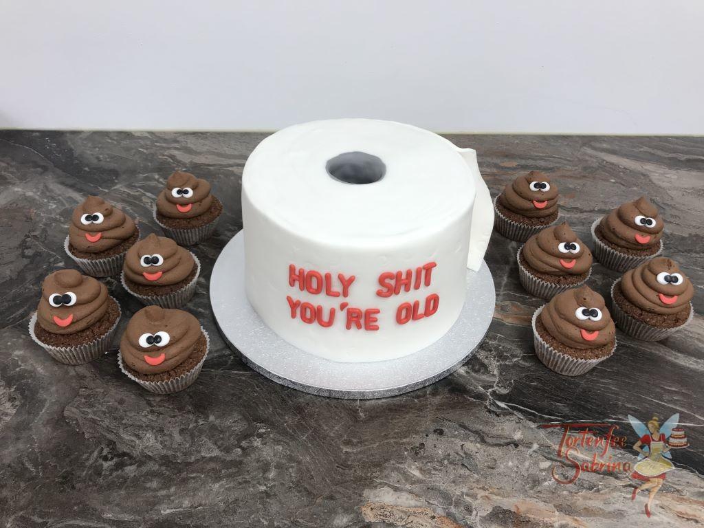 Geburtstagstorte Erwachsene - Häufchen mit Klopapier, hier gibt es braune Cup Cakes und eine weiße Torte in Form einer Klopapierrolle.