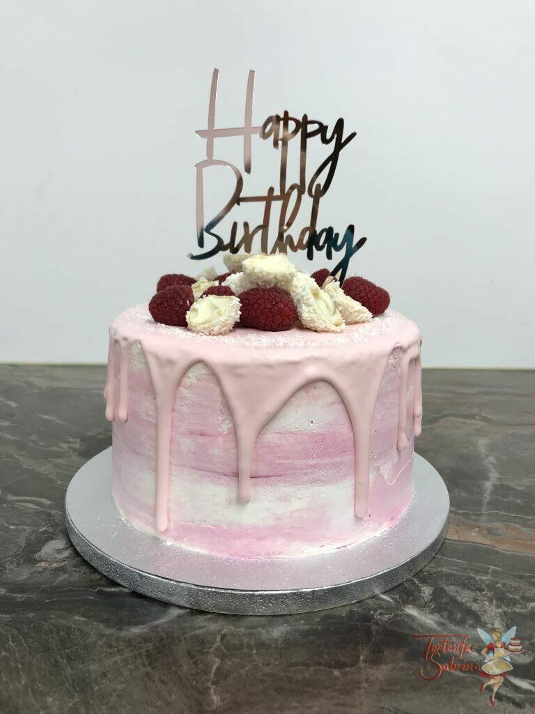 Geburtstagstorte Erwachsene - Himbeeren mit Kokos zieren diesen Drip Cake. Die Torte wurde in zartem rosa eingefärbt und mit eine Cake Topper verziert.