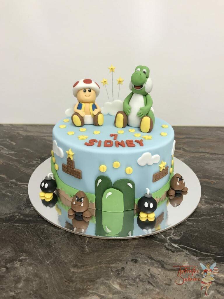Geburtstagstorte Mädchen - Joshi und Toad sitzen auf der Torte, umgeben von dem ersten Level mit den ersten Gegnern und Münzen.