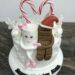Geburtstagstorte Erwachsene - Milky and Schoki in the snow, die beiden sitzen ganz verliebt auf der Torte um geben von Schneeflocken.