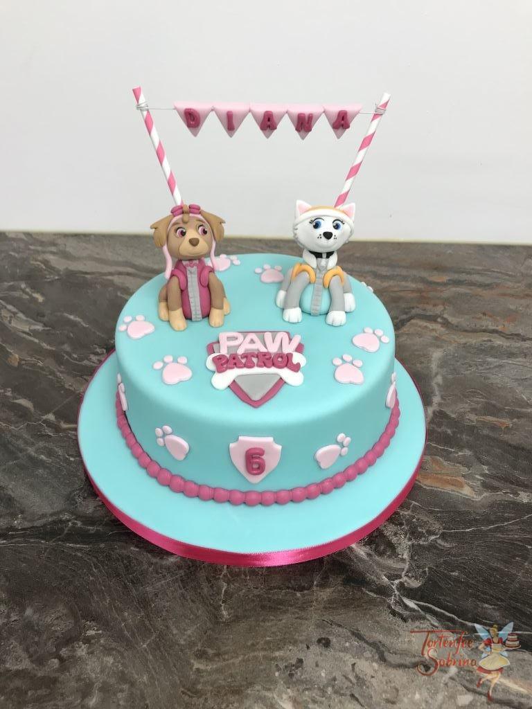 Geburtstagstagstorte Mädchen - Party mit Everest und Skye, dekoriert mit dem Paw Patrol Logo, Pfotenabdrücken und einer Namensgirlande.