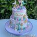 Geburtstagstorte Mädchen - Perlenkette unter dem Wasser in den Farben rosa, lila, türkis und gold mit Muscheln und Seesternen.
