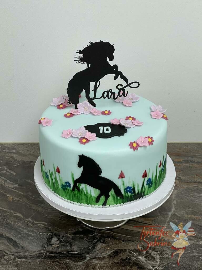 Geburtstagstorte Mädchen - Pferd auf der Blumenwiese zwischen vielen bunten Blumen, ganz oben auf der Torte der Cake Topper als Pferd.