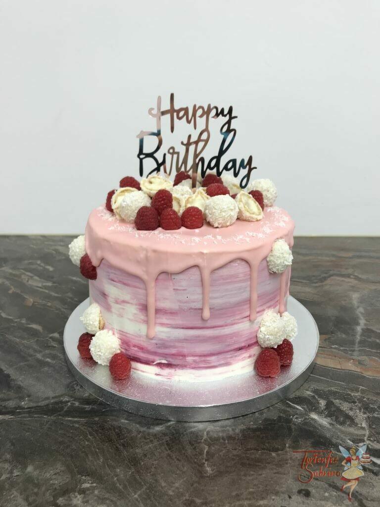 Geburtstagstorte Erwachsene - Rosa Drip mit Süßem, die Torte wurde außen rosa-marmoriert eingestrichen und mit Früchten und Süßem verziert.