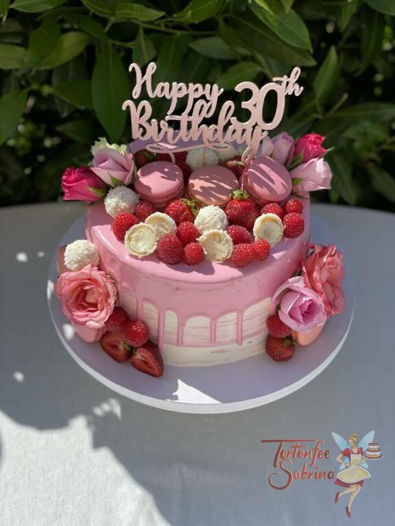 Geburtstagstorte Erwachsene - Rosa und süß mit Rosen auf einem schön, glänzenden rosa Drip.