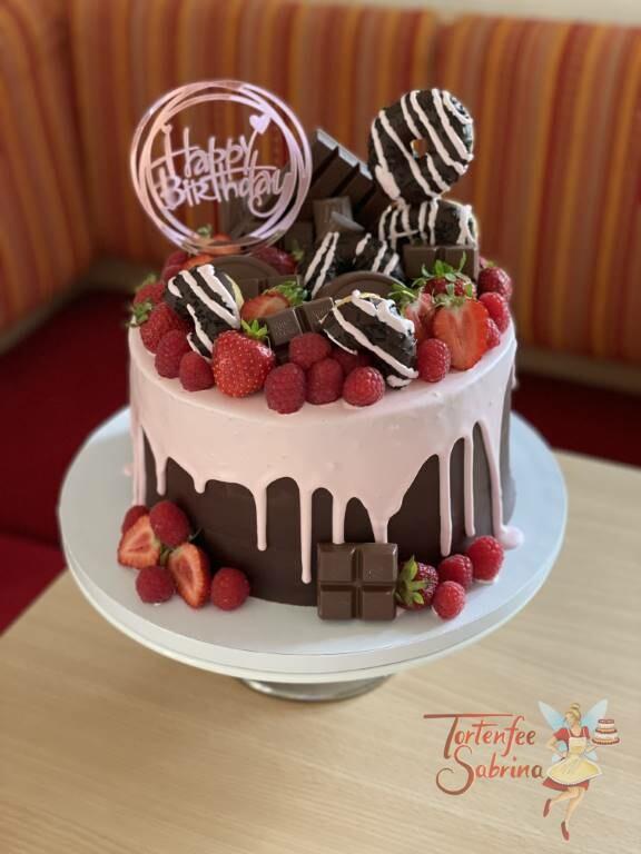 Geburtstagstorte Erwachsene - Süßigkeiten mit Früchten wurden auf diesen schönen rosa Drip gesetzt und dekoriert.