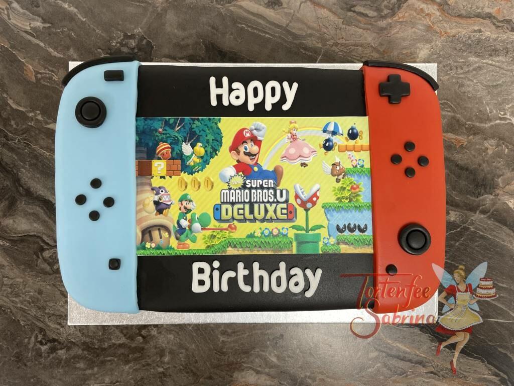 Geburtstagstorte Buben - Super Mario Bros.U Deluxe läuft gerade auf dem Bildschirm der Nintendo Switch mit den Farben rot und blau.