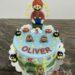 Geburtstagstorte Buben - Super Mario geht durch die Röhre in das nächste Level mit seinen kleinen Gegner und Münzen.