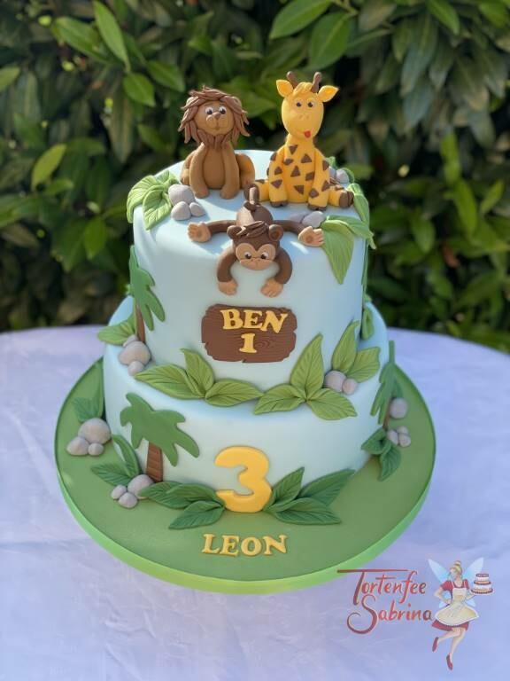 Geburtstagstorte Buben - Tiere im Dschungel fühlen sich wohl, das sieht man dem Affen, dem Löwen und der Giraffe an.