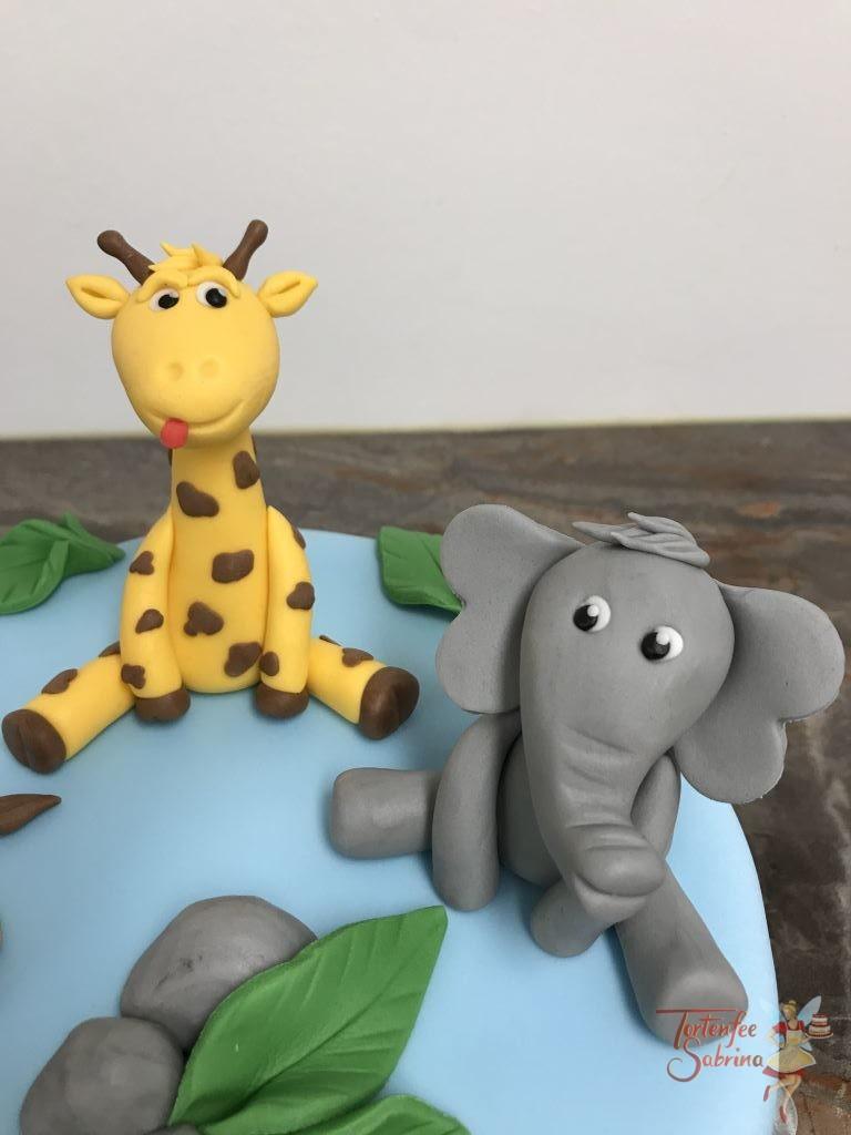 Geburtstagstorte Buben - Tiere unter Palmen, hier treffen sich ein Löwe, Elefant und eine Giraffe und genießen ihren Platz bei den Palmen.