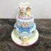 Geburtstagstorte Mädchen - Valerie mit Hase und Schaf. Die Torte wurde noch mit einer blauen Schleife, Wolken und vielen bunten Blumen.