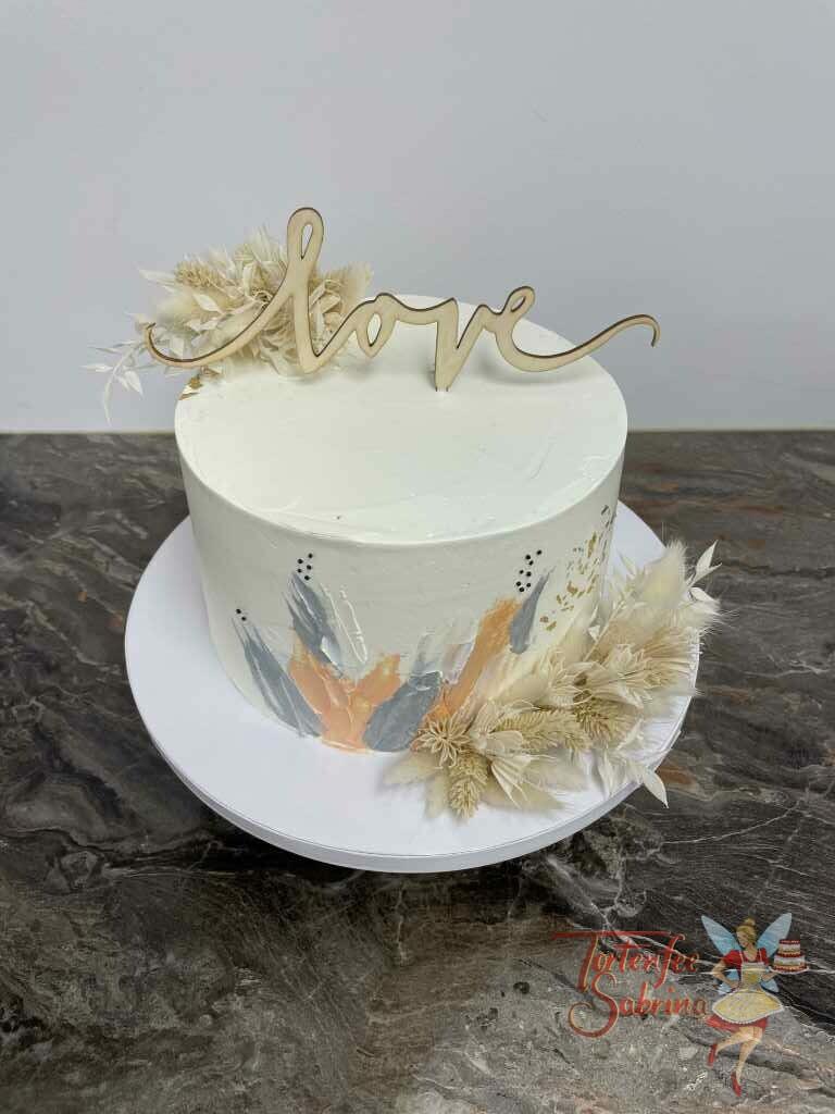 Hochzeitstorte - Blumen mit Farben, hier wurde die Torte mit eingefärbter Buttercreme und Trockenblumen verziert.