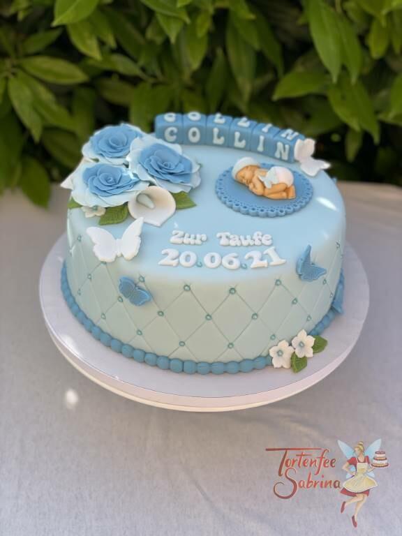 Tauftorte - Baby mit Windel und Haube liegt auf einer kleinen Decke, verziert ist die Torte mit blauen Rosen und Schmetterlingen