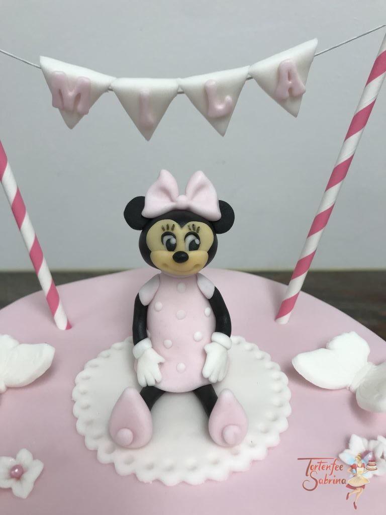 Tauftorte - Minnie in rosa ziert die Torte oben, sowie eine Girlande mit dem Namen des Taufkindes.