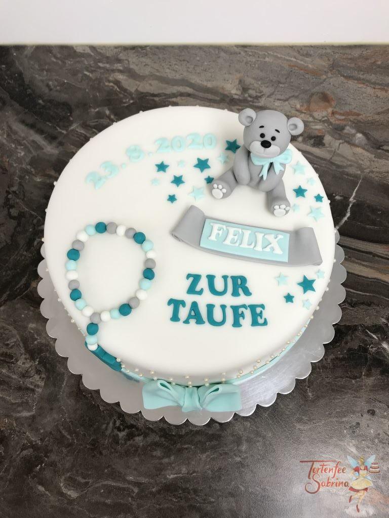 Tauftorte - Niedliches Bärchen mit türkiser Schleife, Sternen und einem Kreuz. Der Rand der Torte wurde mit Zuckerperlen besetzt.