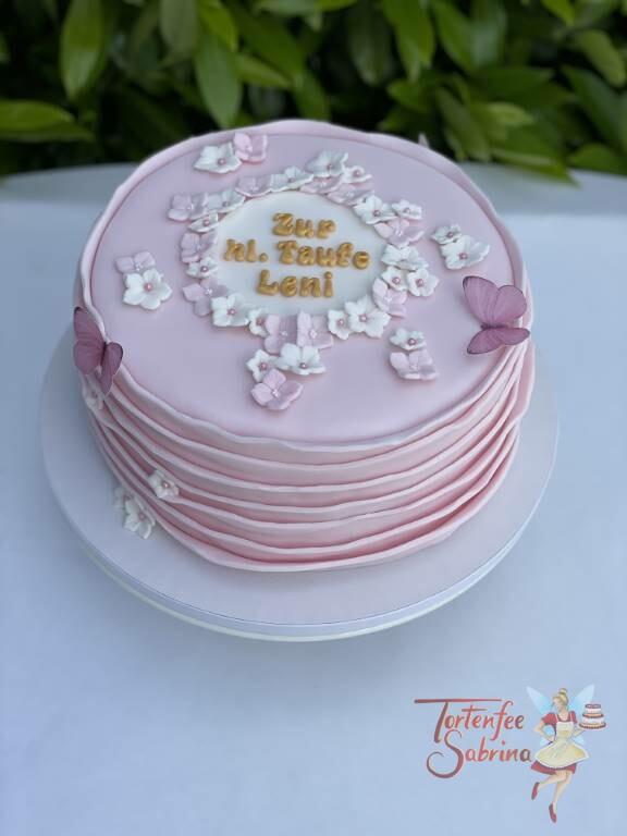 Tauftorte - Rosa Wellen mit Blumen in weiß und rosa, der Name wurde in gold geschrieben.