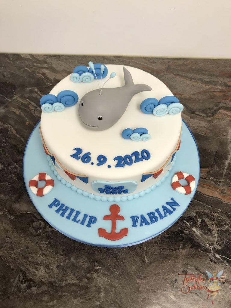 Tauftorte - Wal im Meer, diese Torte wurde zusätzlich noch mit Wellen, einem Anker und Schwimmreifen verziert.